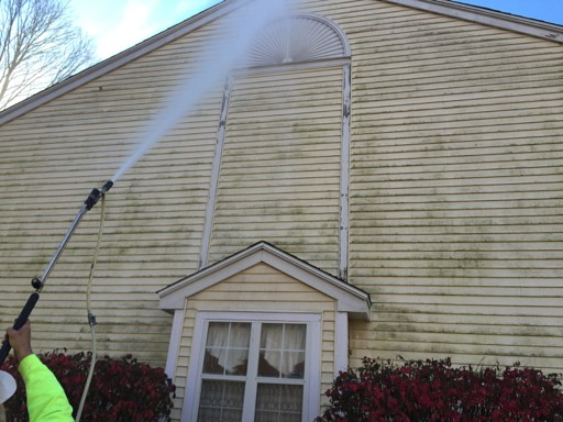 Power washing hose begins the job of cleaning a dirty house
