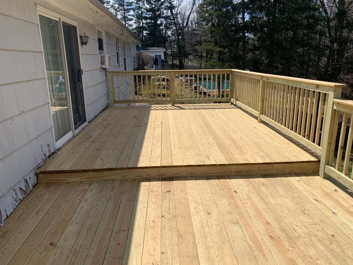 Beautifully restored floor, railing and bench on this deck