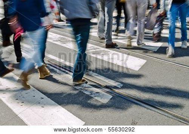 This photograph of people walking appears slightly awkward as is, but could be a great background with editing