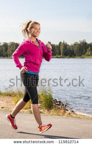 This smiling runner floating off the ground looks fake.